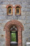 Emoji from the 16th century. A doorway and windows of an old stone church from the 16th century Royalty Free Stock Photos