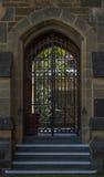 Doorway. Wrought iron gates closed set in stone masonary framework Stock Images