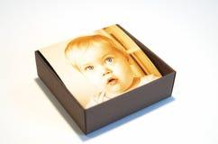 Doos met babyportret Stock Foto's