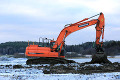 Doosan Excavator at Work in Winter Royalty Free Stock Photos