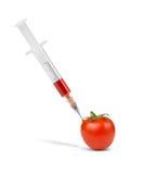 Dopage de la tomate végétale photographie stock libre de droits