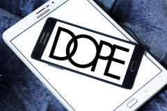 Dope brand logo. Logo of Dope brand on samsung mobile. Dope is a street wear brand. The clothing line is available in boutiques worldwide stock photo
