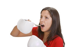 Doping. Athelte woman with box gloves taking a spoon of pills to enhance her performances Royalty Free Stock Image