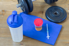 Doping at professional sport. Urine tests syringe and sports equipment Stock Image