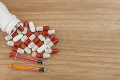 Doping in sport. Abuse of anabolic steroids for sports. Anabolic steroids spilled on a wooden table Royalty Free Stock Photo