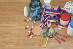 Doping in sport. Abuse of anabolic steroids for sports. Anabolic steroids spilled on a wooden table. Fraud in sports. Pharmaceutical industry. Detailed view of Stock Photo
