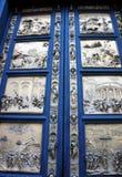 Dopkapell för dörrpanelsofDuomo, Florence, Italien Royaltyfria Bilder
