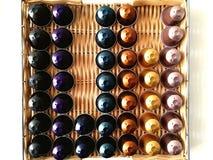 Dopo caffè le capsule è usata per la decorazione fotografia stock