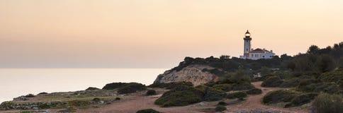 Dopo i colori di tramonto intorno al faro Fotografie Stock Libere da Diritti