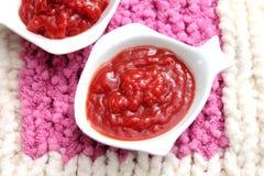 Dopp av tomater och chili Arkivfoto