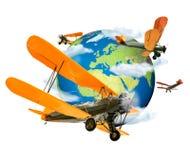 Doppeldecker, die rund um den Globus fliegen Stockfotografie