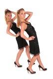 Doppelmädchen. Abdachung hinter Hand oben. stockfotografie