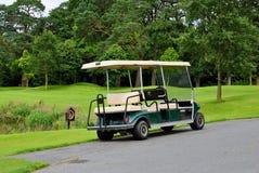 Doppelter Golfwagen Stockfoto
