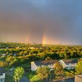Doppelter Regenbogenbogen Stockbild