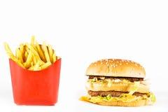 Doppi cheeseburger e patate fritte Fotografie Stock