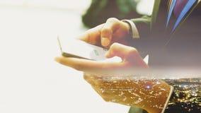Doppia esposizione di un uomo che usando Smartphone Fotografia Stock Libera da Diritti