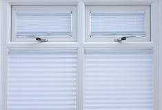 Doppie finestre lustrate bianche   Immagine Stock