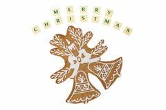 Doppio pan di zenzero delle campane di Natale con desideri su bianco Fotografie Stock Libere da Diritti