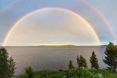 Doppio Rainbow sopra il lago Immagine Stock Libera da Diritti