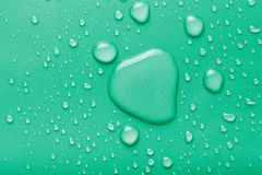 Dops of water on a color background. Green. Toned Royalty Free Stock Images