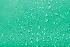 Dops of water on a color background. Green. Toned Stock Images