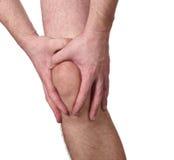 Dor aguda em um joelho do homem Foto de Stock