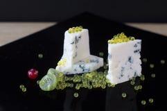 Dor Blue och honungkaviar Arkivfoto