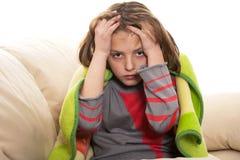 dor de cabeça da criança Fotos de Stock