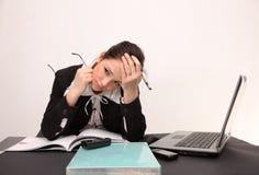 Dor de cabeça da mulher de negócios Fotos de Stock Royalty Free