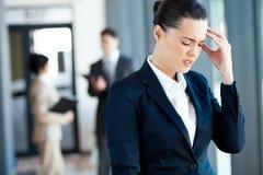 Dor de cabeça da mulher de negócios Imagem de Stock Royalty Free