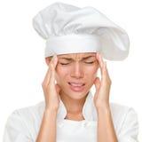 Dor de cabeça e esforço do cozinheiro chefe no trabalho Fotos de Stock Royalty Free