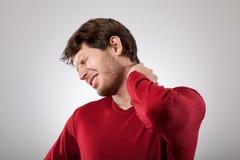 Dor de pescoço fotografia de stock