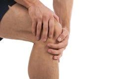 Dor do joelho. Imagens de Stock