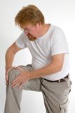 Dor do joelho do homem Foto de Stock