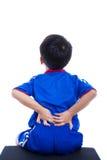 Dor traseira Criança que fricciona os músculos de sua mais baixa parte traseira Fotografia de Stock