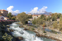 Dora Baltea River and Ivrea cityscape in Piedmont, Italy.  royalty free stock photography