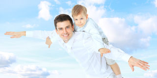 Dorable arms baby beach beautiful blue boy caucasian child cloud cute dad daddy Royalty Free Stock Photo