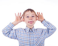 Dorable young grimace boy. Royalty Free Stock Photos