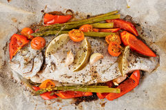 Dorade with vegetables roasted in culinary paper Stock Images