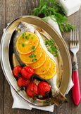 Dorado fish baked with tomatoes Royalty Free Stock Images