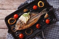 Dorado fish cooking on the grill pan close-up. horizontal  top v Stock Photos