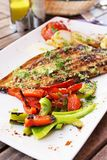 Dorado fish fillet with vegetables Stock Images