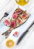 Dorado fish with lemon and figs Stock Image