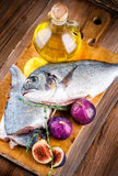 Dorado fish with lemon and figs, Mediterranean Stock Images