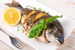Dorado fish with lemon and spices Stock Photo