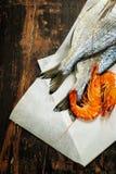 Dorado fish and shrimps Stock Images
