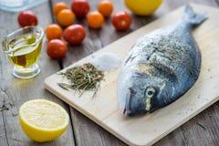 Dorado fish on slate board Royalty Free Stock Photo