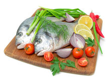 Dorado fish and vegetables on white background Royalty Free Stock Photography