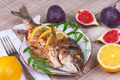 Dorado served with lemon and figs; Royalty Free Stock Photos