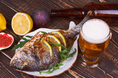 Dorado served with lemon and figs Royalty Free Stock Image